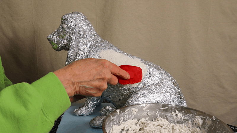 Add paper mache clay to the Basset Hound sculpture