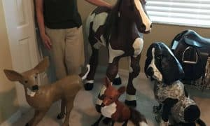 Connie Kulow with paper mache aqnimals