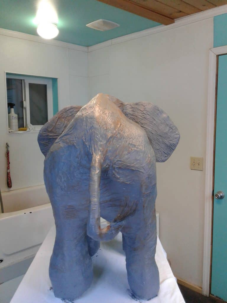 Paper mache elephant from the rear.