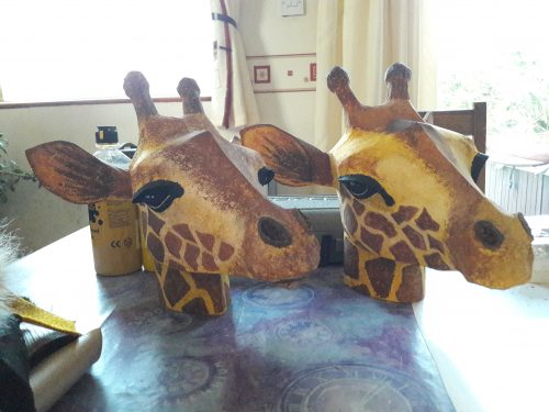 Giraffe heads for the Lion King.
