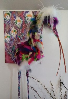 Paper mache bird with feathers