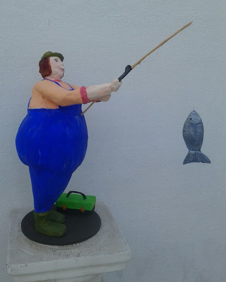 Fat girl fishing paper mache sculpture