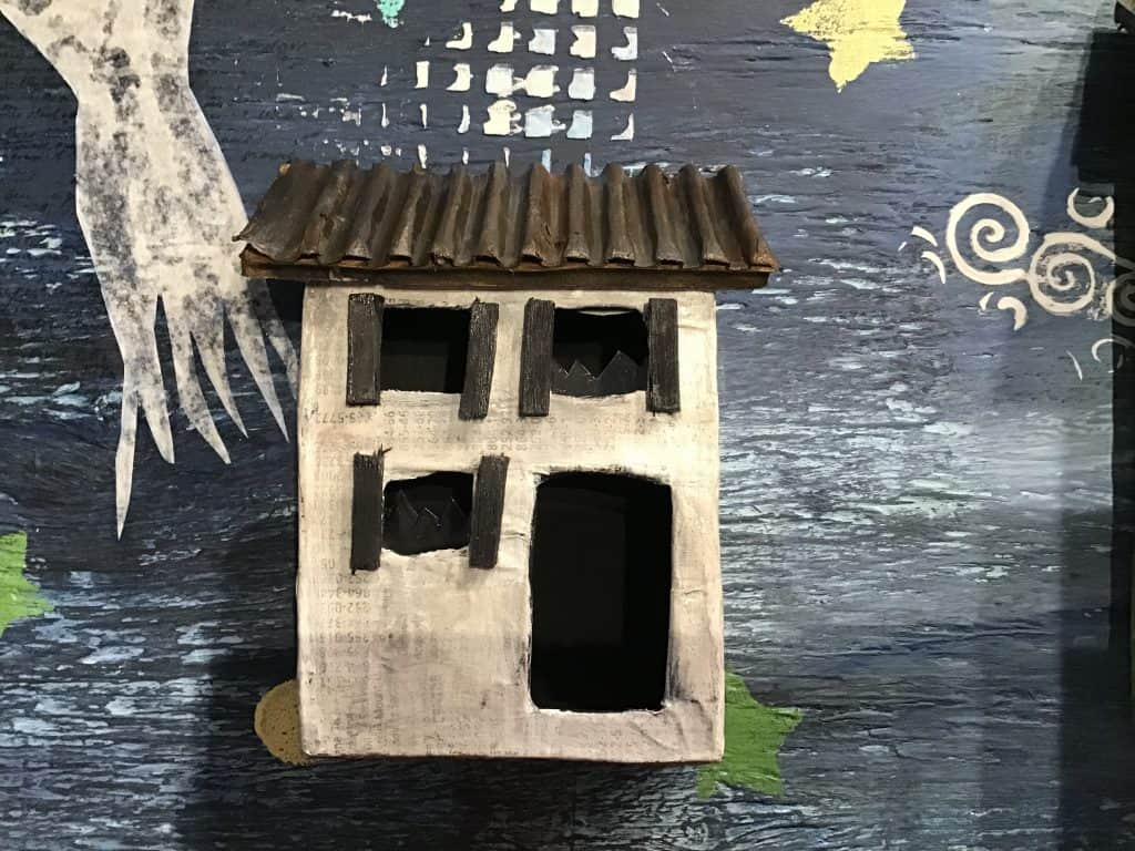 Paper mache sculpture of abandoned houses