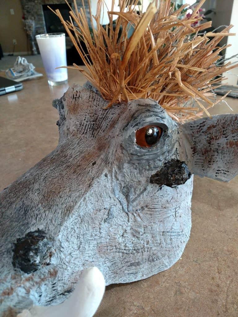 Pumbaa mask with raffia mane