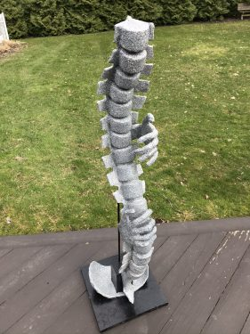 Humorous spine sculpture made with air dry clay