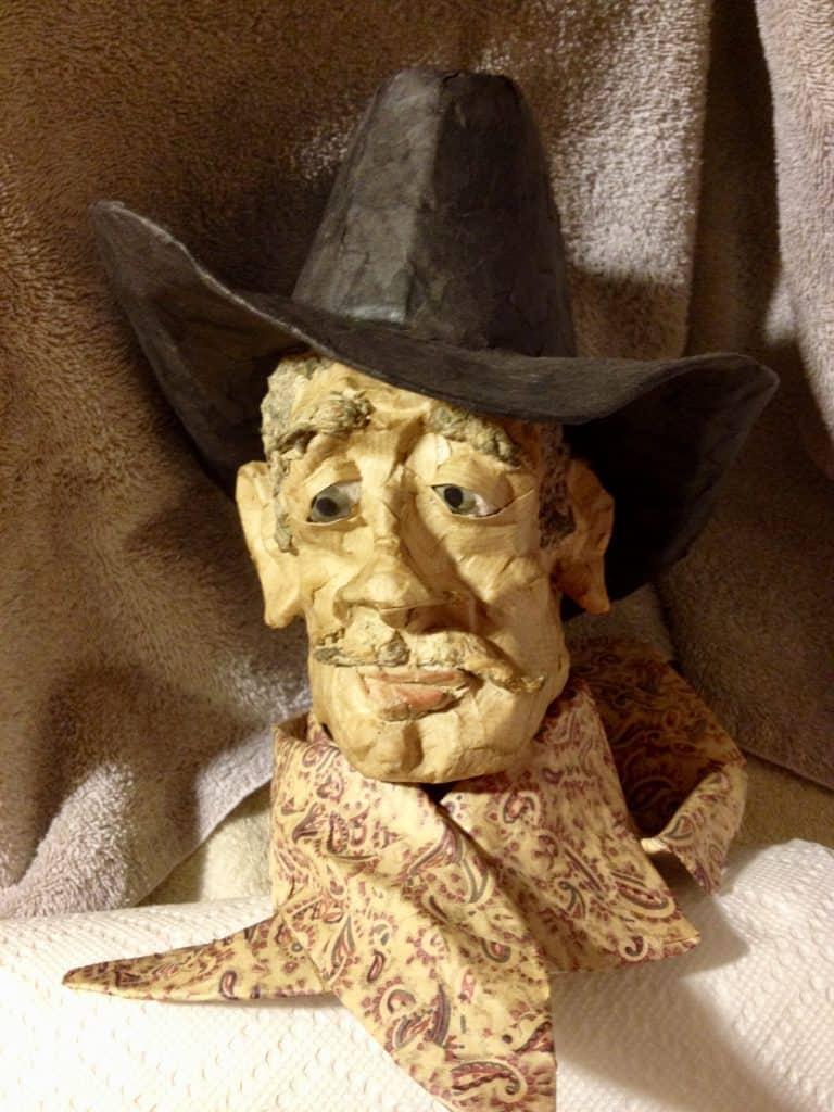 """""""Gnarly Cowboy"""" paper mache portrait"""