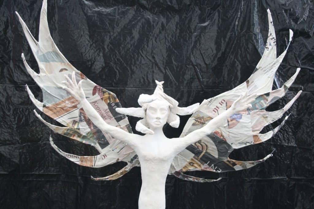 Paper mache on angel wings
