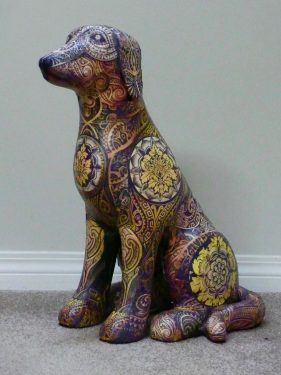 Dog sculpture made with foam and paper collage