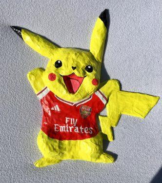 Paper Mache Pokemon in Arsenal football team kit