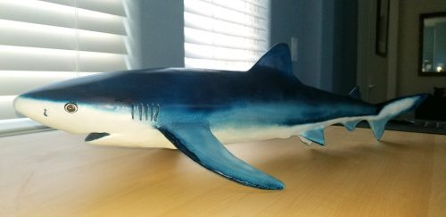 Blue shark sculptures with paper mache clay