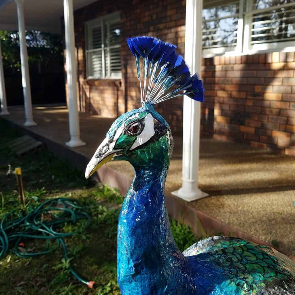 Paper mache peacock's head