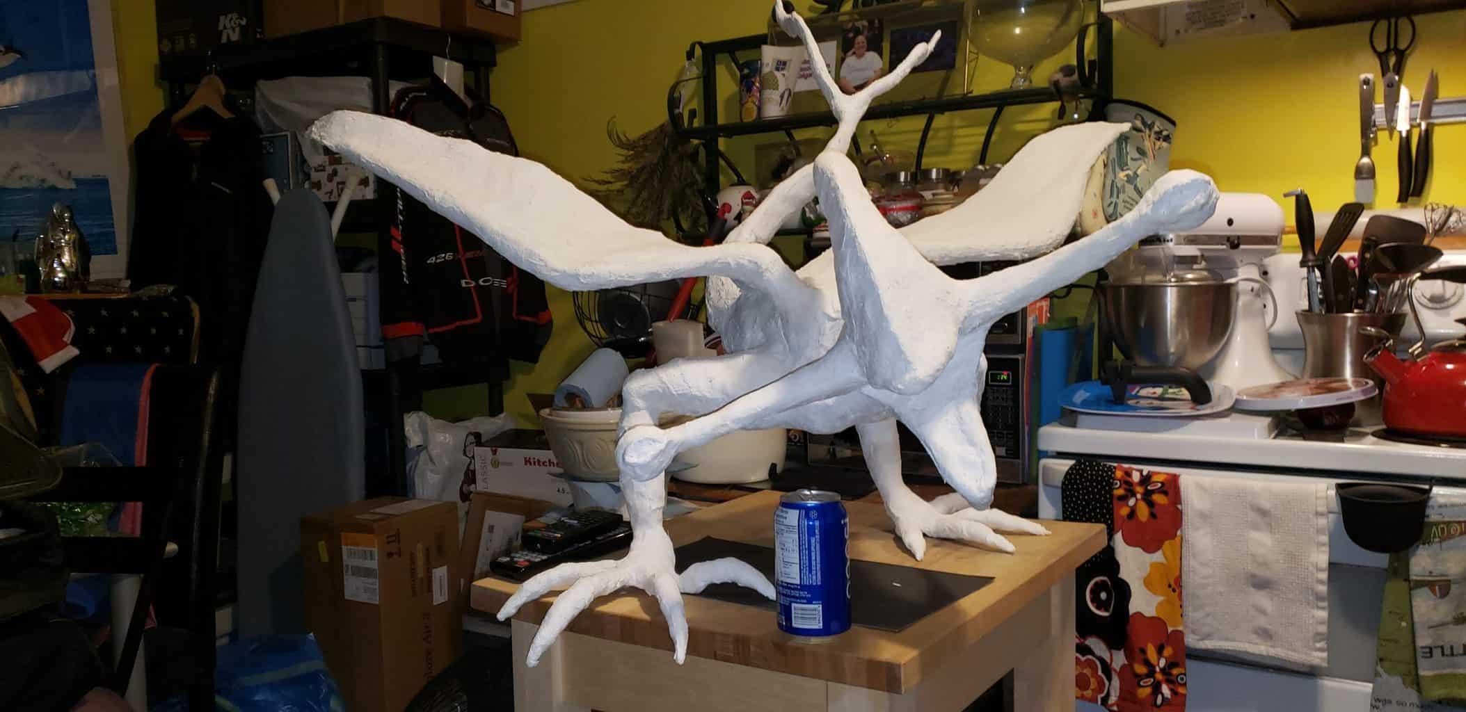 Paper mache bioraptor statue