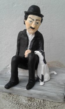Paper mache Charles Chaplin with dog