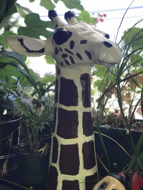 Queen Nefertiti - a paper mache giraffe head sculpture