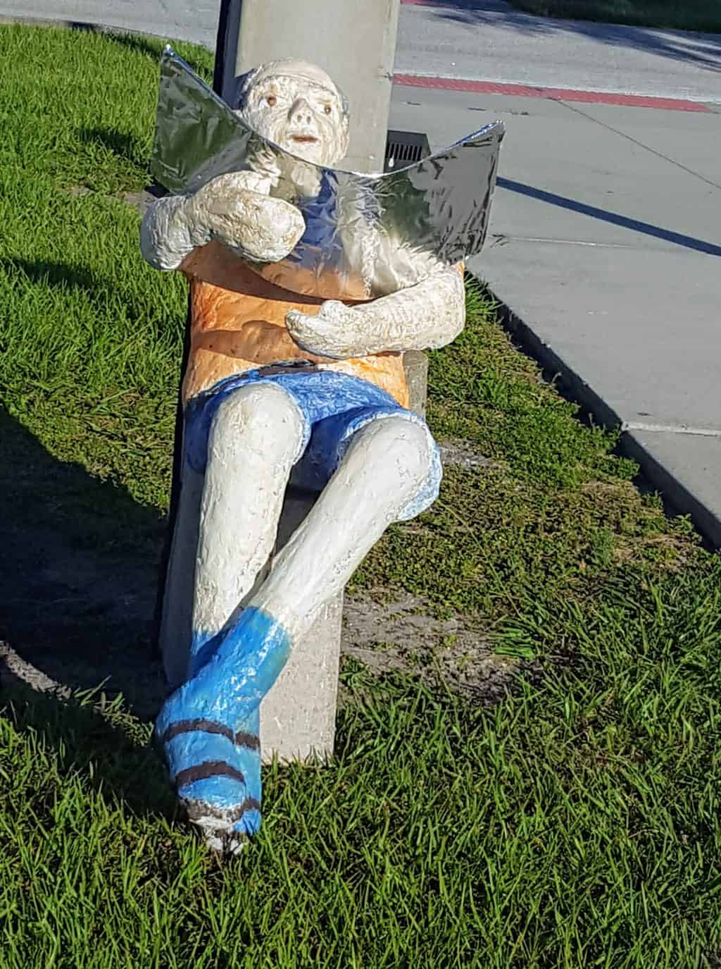 Catching rays, paper mache figure sculpture