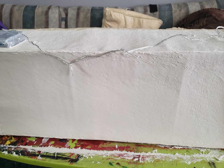 cardboard warped with paper mache