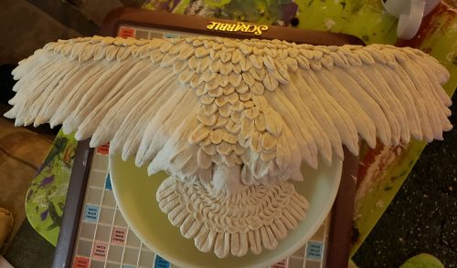 Sculpted feathers on the back of a snowy owl sculpture in progress