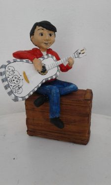Miguel from the movie Coco made with paper mache
