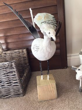 """Refuge"" paper mache bird sculpture"