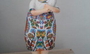 Paper mache figure sculpture with dog