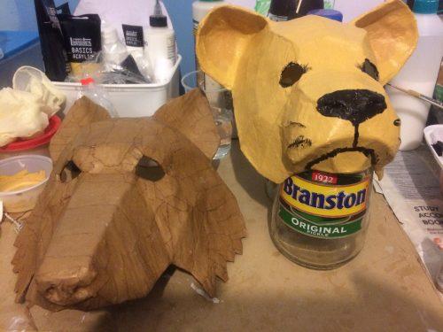 Paper mache lion and wolf masks