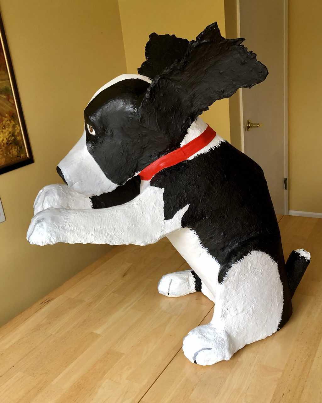 Paper mache dog, riding shotgun