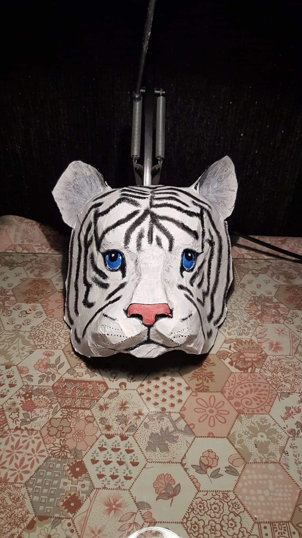 Paper mache tiger cub portrait