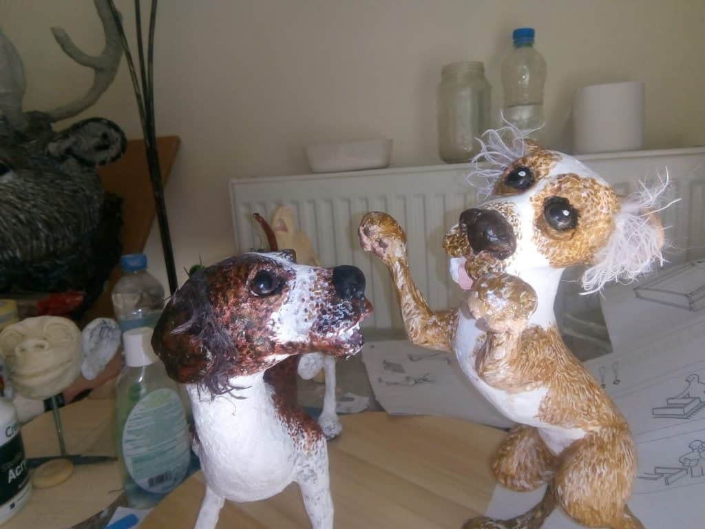 Paper mache dogs playing