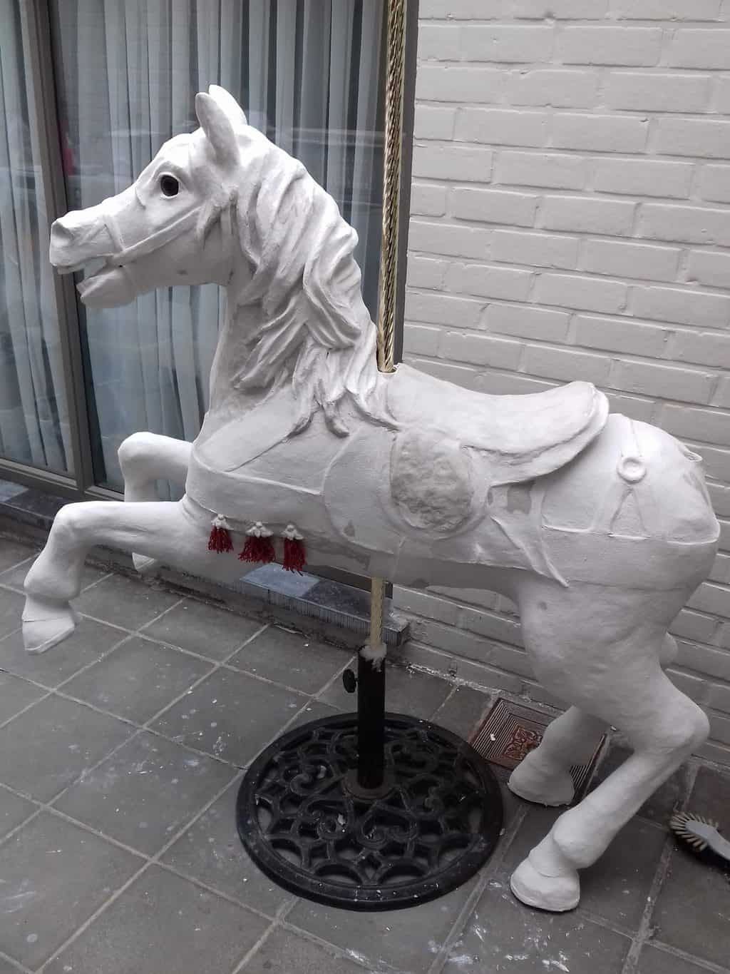 Adding paper mache clay to carousel horse