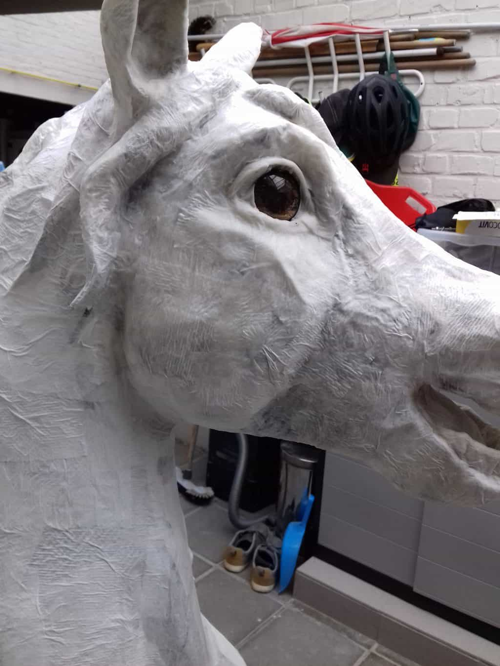 Eye details on paper mache horse