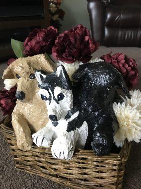 Basket of paper mache puppies
