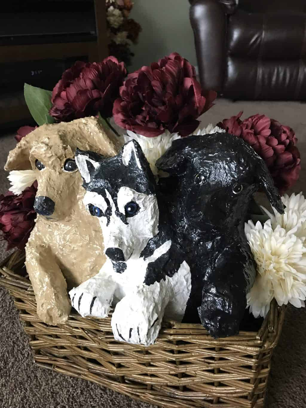 Basket of paper mache puppies