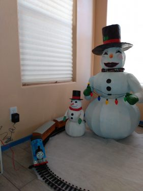 Snowman made from cardboard , tape and papier mache