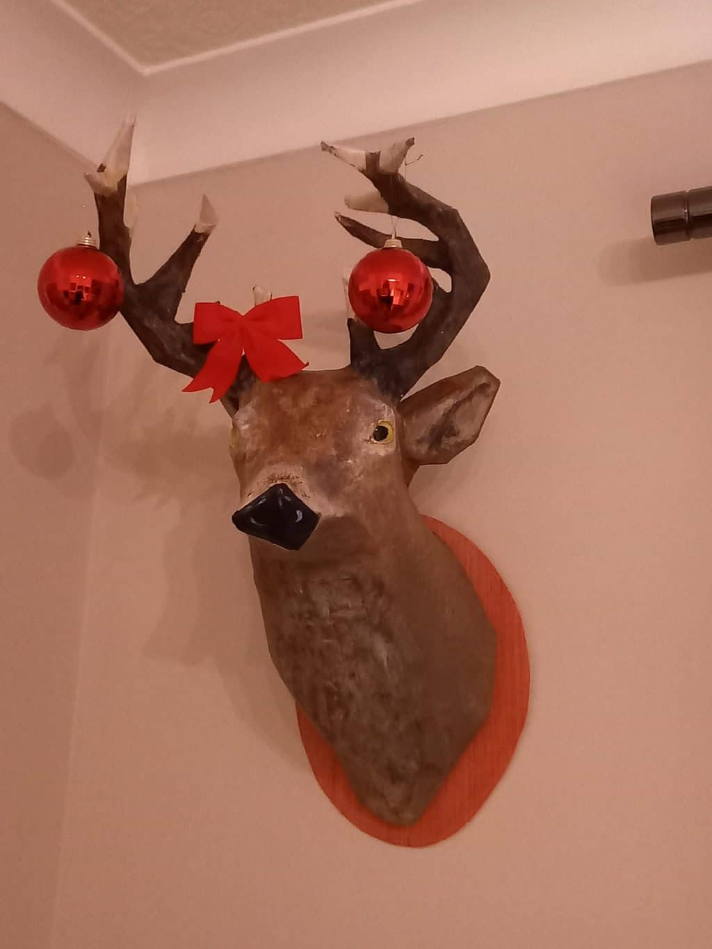 Paper mache stag dressed for Christmas