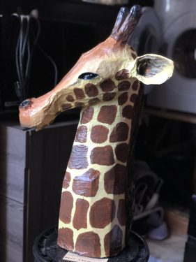 Paper mache giraffe head sculpture