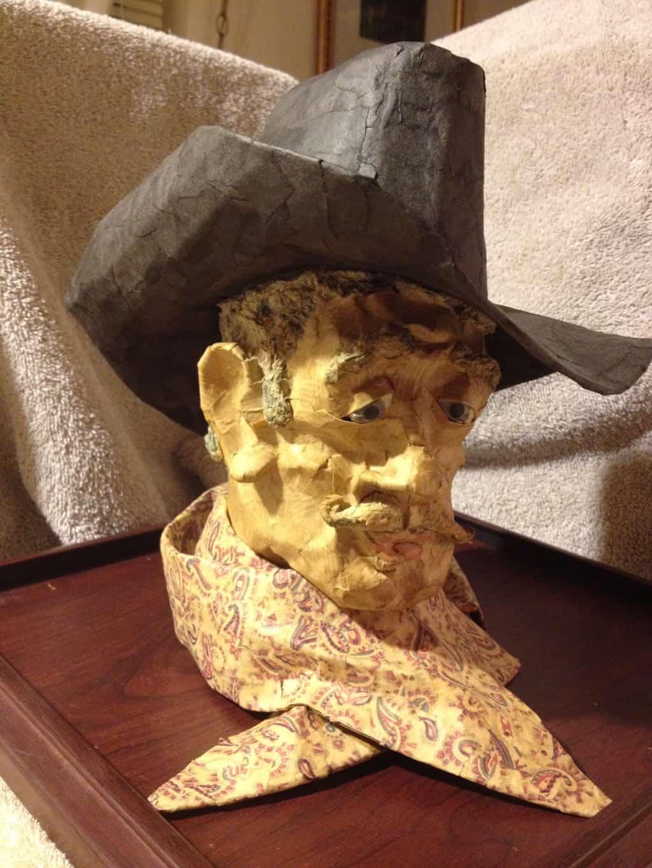 Paper mache cowboy portrait