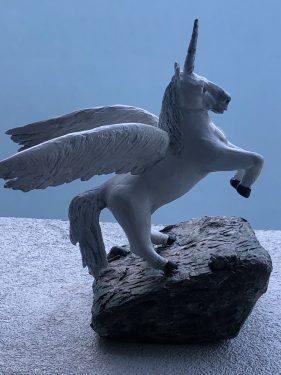 Winged paper mache unicorn