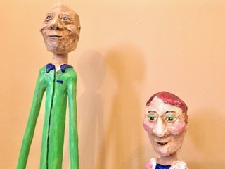Bobble heads made with paper mache clay