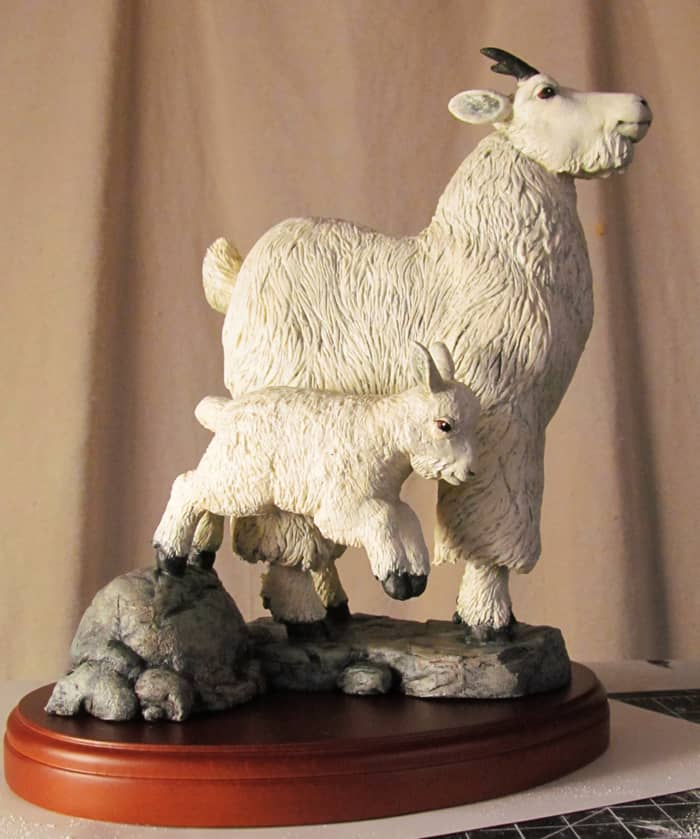 mamma and baby goat sculpture
