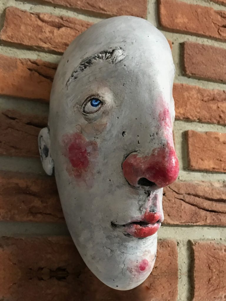 """""""stone"""" face made with instant paper mache."""