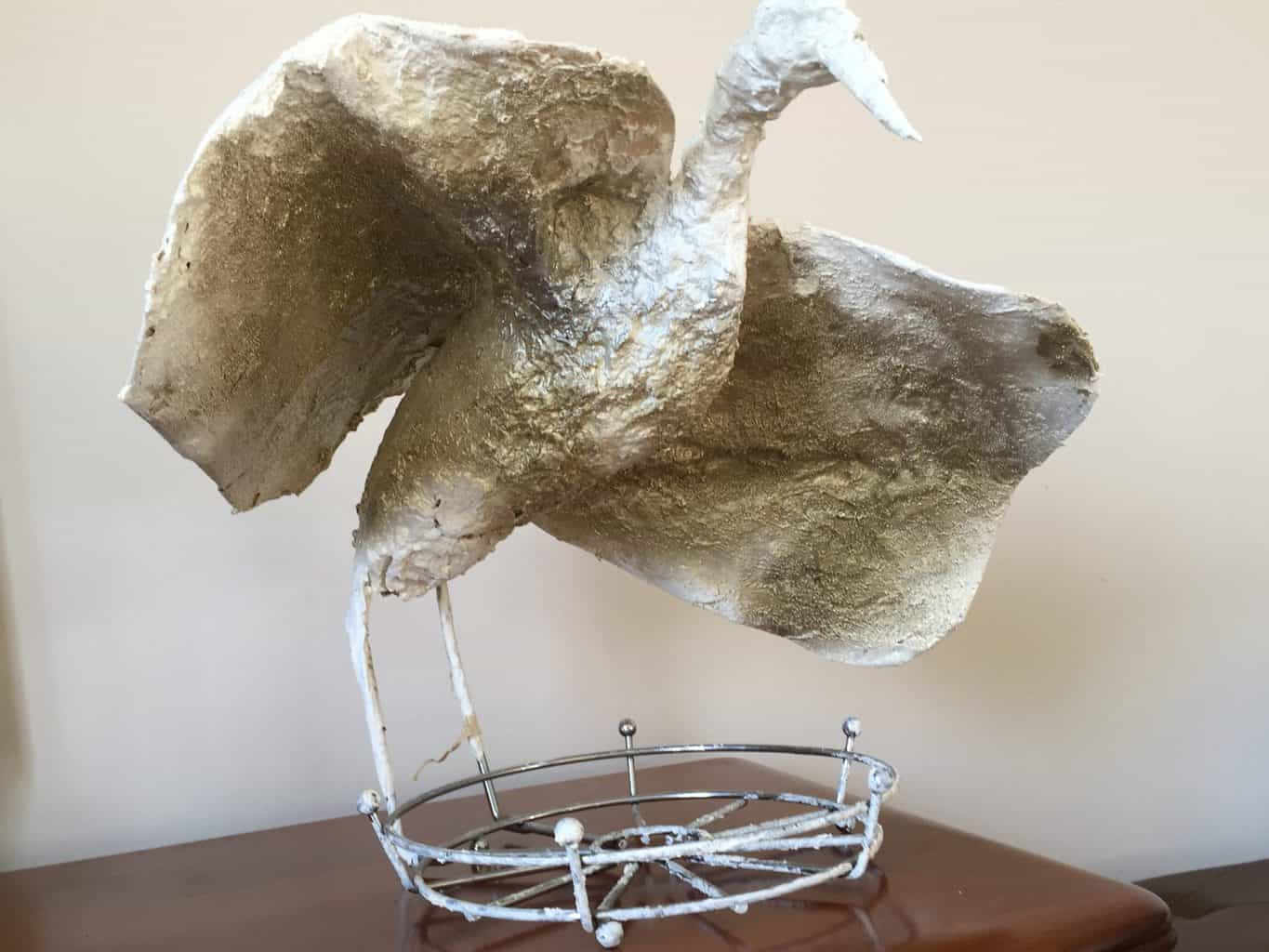 Paper mache bird with outstretched wings