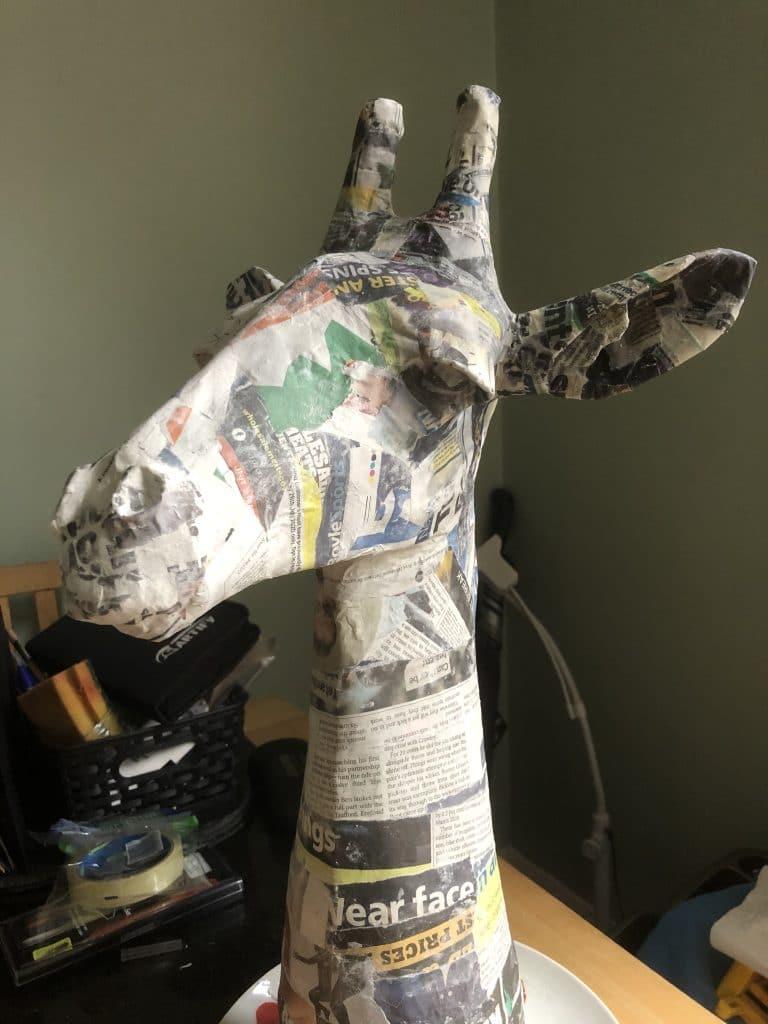 Paper mache giraffe before painting