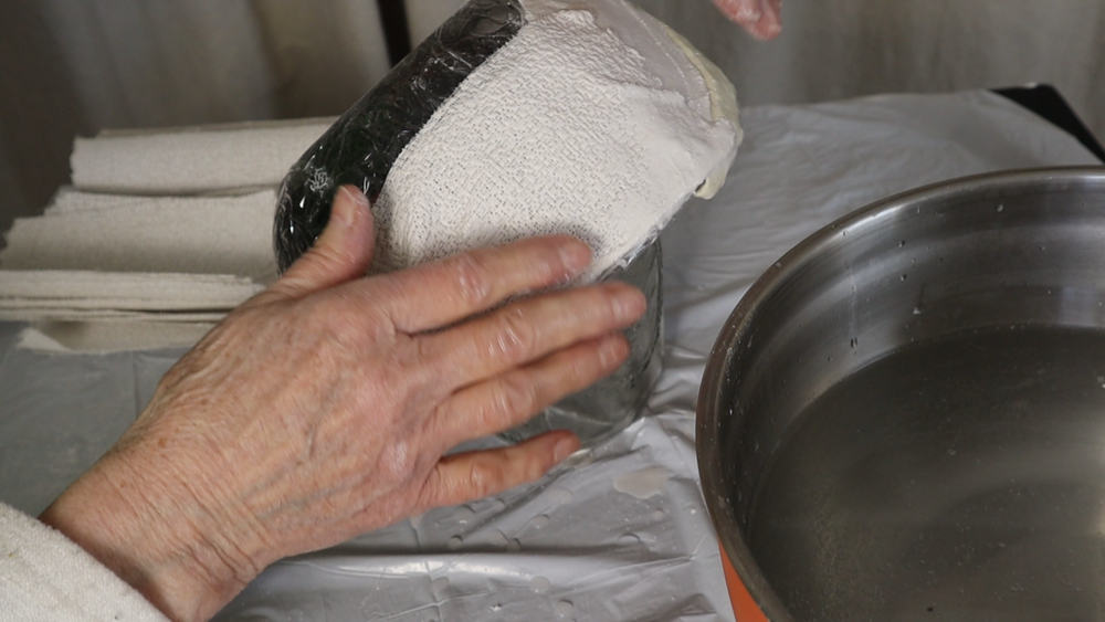 Don't let the plaster cloth go over the edge of the bowl