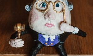 The Judge paper mache egg by Linda Crawford