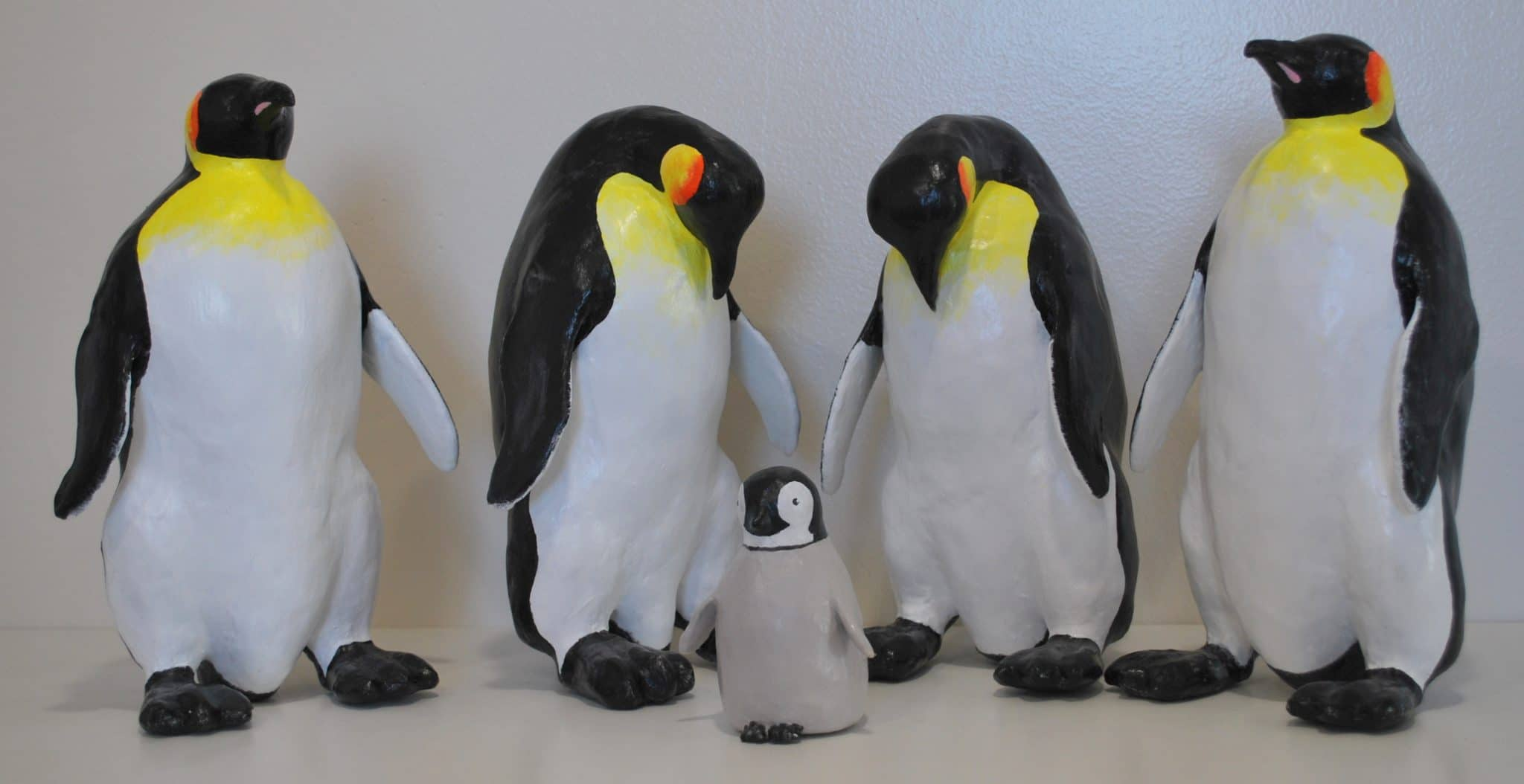 6 Penguins made by Rex Winn with paper mache clay