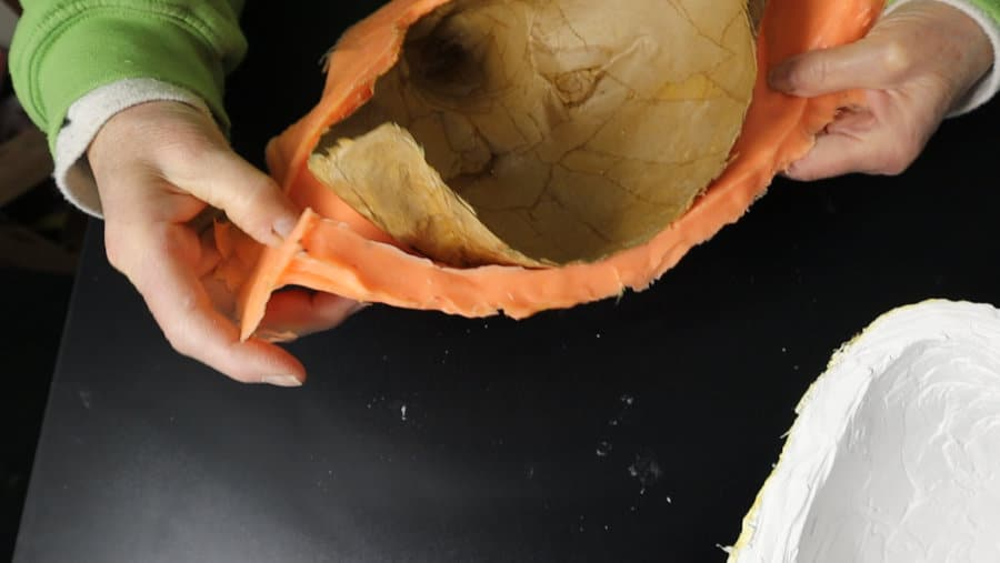 Let paper mache dry before removing from mold