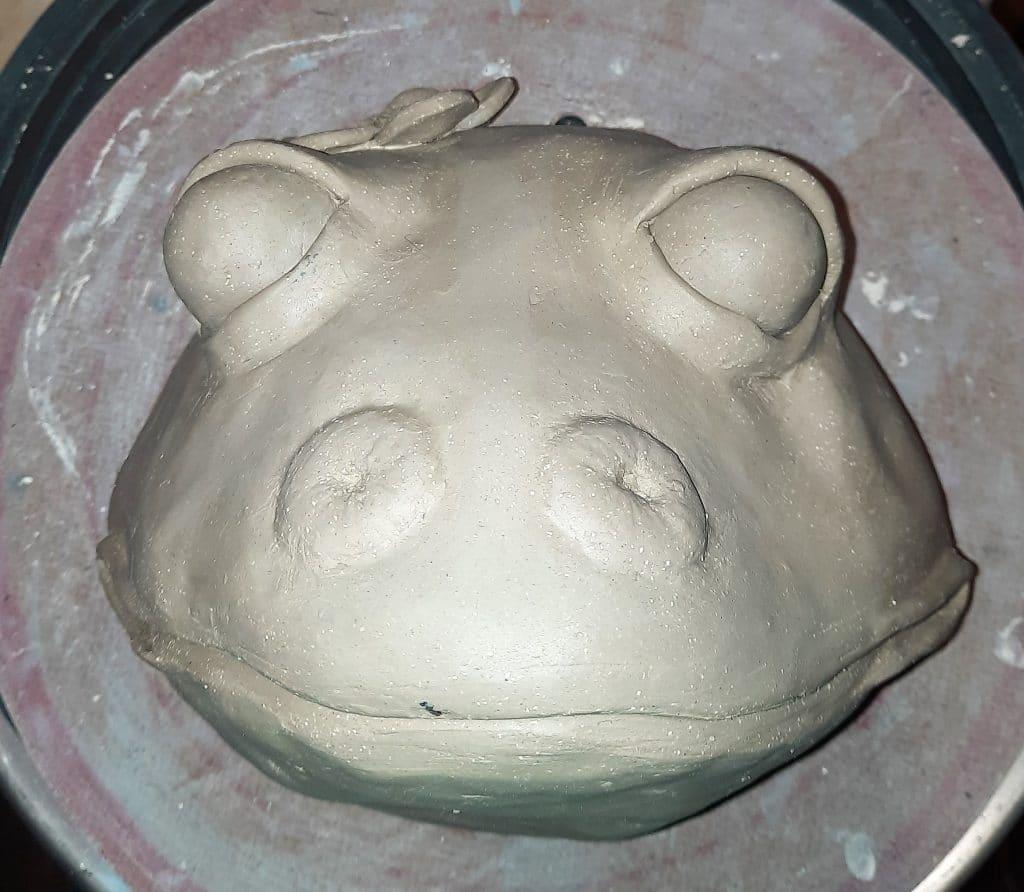 Clay frog wall portrait