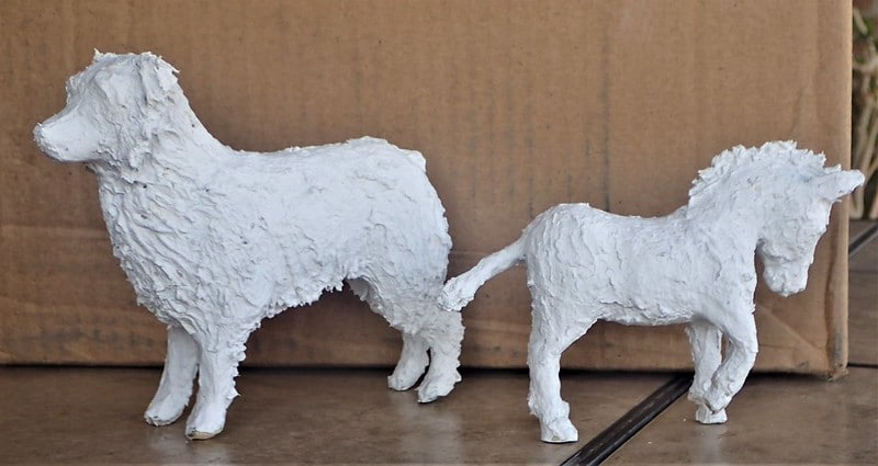 Australian Shepherd and burro in paper mache clay, ready to paint