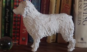 Australian Shepherd in paper mache clay, ready to paint