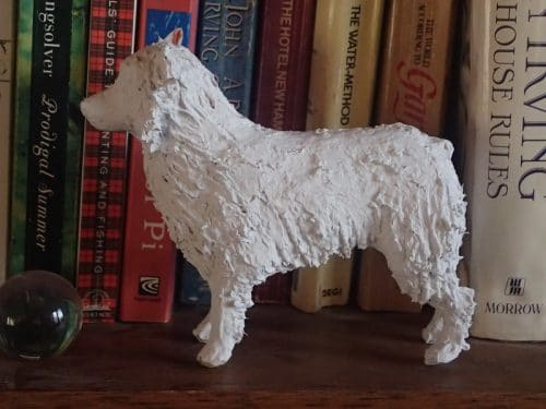 Australian Shepherd in paper mache clay, ready to paint